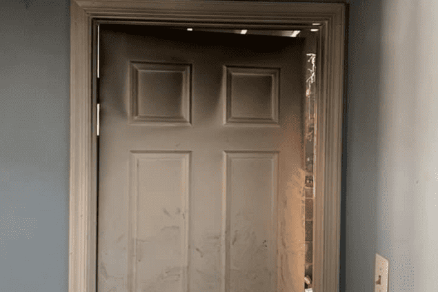 closed door with discoloring at the top